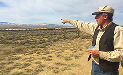 Rancher T. Wright Dickinson surveys sage grouse habitat on his cattle's summer range. (JZ)