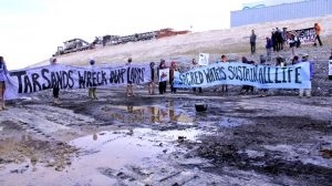 Protestors with Peaceful Uprising at the test pit of the planned Utah tar sands mine (via Peaceful Uprising)